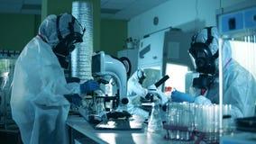People develop a vaccine for coronavirus treatment in modern laboratory.
