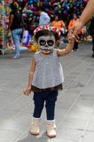 People on the Dia de los Muertos in Mexico. OAXACA, MEXICO - OCT 31, 2016: Unidentified girl painted as zombie for the Day of the Dead (Dia de los Muertos) Stock Images