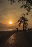 People did their activities in the park near the sea in morning ; Songkhla province, Thailand. Silhouette style Royalty Free Stock Photo