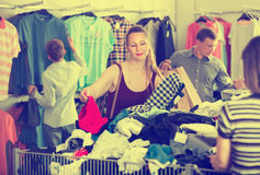 People of different ages choosing clothes at the outlet royalty free stock photography