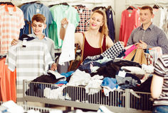 People of different ages at the clearance sale shop Royalty Free Stock Images