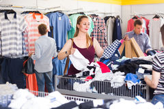 People of different ages at the clearance sale shop royalty free stock photography