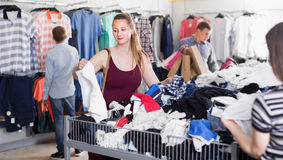 People of different ages at the clearance sale store royalty free stock photography