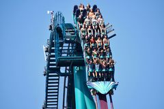 People of different ages thrilled and scared by fast descent riding Mako Roller Coaster at Seaw. Orlando, Florida. October 19, 2018 People of different ages royalty free stock photography