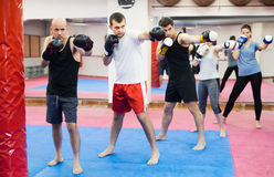 People of different ages training at kickboxing stock photo
