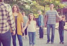 People of different ages walk in park. Smiling people of a different ages walk in park on holiday stock photo