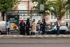 People of different ethnic groups are waiting in a public transp Stock Photography