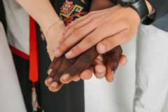 People of different nationalities and religions hold hands. The concept of friendship among peoples. The concept of. People of different nationalities and Royalty Free Stock Photography