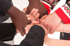 People of different nationalities and religions hold hands. The concept of friendship among peoples. Business concept of team building and partnerships royalty free stock image