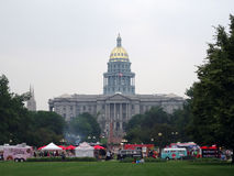 People dine at Food Truck at Civic Center with capitol building Royalty Free Stock Image