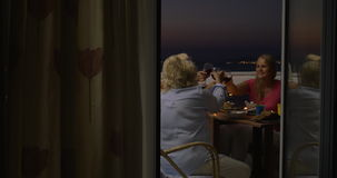 People dining and drinking wine on balcony stock video footage