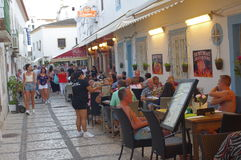 People dining out at outdoor restaurants. People are dining out at outdoor restaurant on the streets of Albufeira in western Algarve in Portugal Royalty Free Stock Photo