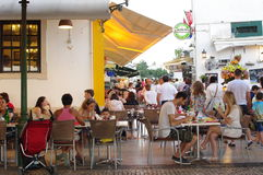 People dining out at outdoor restaurants. People are dining out at outdoor restaurant on the streets of Albufeira in western Algarve in Portugal Stock Photos