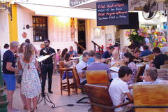 People dining out at outdoor restaurants. People are dining out at outdoor restaurant on the streets of Albufeira in western Algarve in Portugal Stock Images