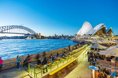 People dining at outdoor restaurants in Circular Quay in Sydney, Australia Royalty Free Stock Photos