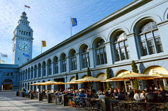 People dining in restaurant in San Francisco Ferry Building. SAN FRANCISCO - MAY 21 2015:People dining in restaurant in San Francisco Ferry Building.It's royalty free stock photos