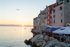 People dining at restaurants of Rovinj on Croatia. Rovinj, Croatia - 24 August 2004: People dining at restaurants at the picturesque town of Rovinj on Croatia Royalty Free Stock Photography