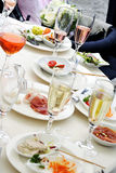 People at a dinner party - view of the table Royalty Free Stock Images