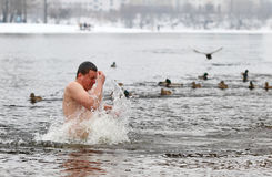 People dip in icy water during Epiphany celebration Royalty Free Stock Photography