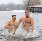 People dip in icy water during Epiphany celebration Stock Image