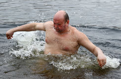 People dip in icy water during Epiphany celebration Stock Photos