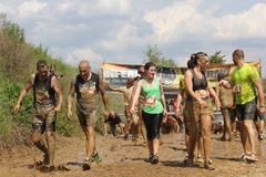 People dirt with mud during a Mud Run competition Stock Image