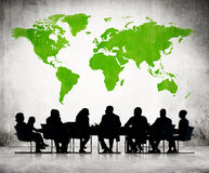 People Discussing Around The Conference Table. Business People Discussing Around The Conference Table And A Green Cartography Of The World Above vector illustration