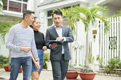 People discussing new house using tablet pc royalty free stock photo