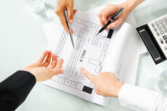 People discussing about property site plan Stock Photo