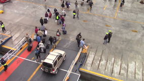 People disembarking from the ferryboat stock video