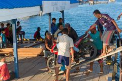 People disembarking scooter from ferry boat Stock Photos