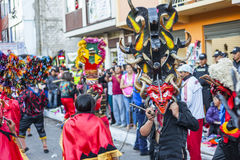 People disguised as devils dancing on streets. Pillaro, Ecuador - january 6: People disguised as devils dancing on streets of Pillaro, Ecuador Diablada de Royalty Free Stock Photo