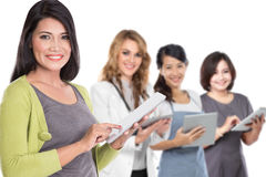 People in diverse ethnicity using modern gadget Royalty Free Stock Photography