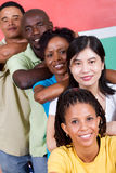 People diversity. People unity: group of diversity people together, background is south african flag, 2010 fifa world cup concept royalty free stock images