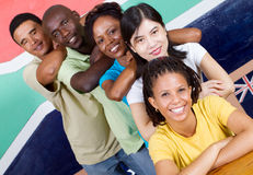People diversity. People unity: group of diversity people together, background is south african flag, 2010 fifa world cup concept stock image