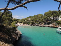 People diving in turqouise water. Near the beach Cala Serena, Cala d'Or, Mallorca, Spain Royalty Free Stock Images