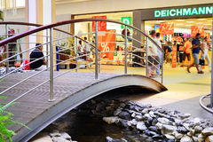Small walkover bridge over an indoor stream in the Vivo! shopping mall (formerly Polus) leading to a Deichmann store Stock Photography