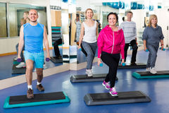 People do crossfit in a fitness club Stock Photo