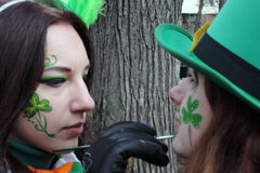 People do make-up at Saint Patrick`s Day celebration in Moscow. Stock Photo