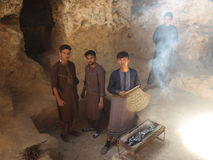 People do picnic in ancient cave, Afghanistan. Royalty Free Stock Photography