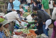 People do shopping at the food market in Luang Prabang, Laos. Stock Image
