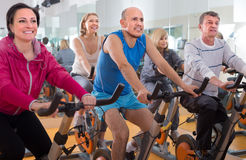 People do sports on exercise bikes Royalty Free Stock Image