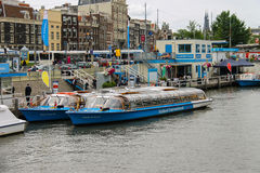 People on the dock landing on river cruise ships, Amsterdam, Net Stock Photo