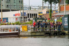 People on the dock landing on river cruise ships, Amsterdam, Net Royalty Free Stock Photo