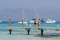 People on the dock of a marina photographing themselves Royalty Free Stock Images