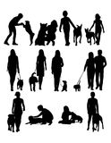 People with Dog Silhouettes Stock Images