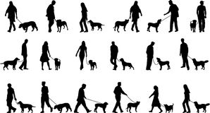 People with dogs. Silhouettes of people with their dogs Royalty Free Stock Photos