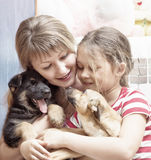 People and dogs Stock Images