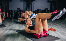 People doing abs in a fitness class Royalty Free Stock Photo