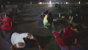 Thailand, Koh Samui, 14 december 2015. People doing acrobatic yoga on the street platform. 1920x1080. People doing acrobatic yoga on the street platform stock video